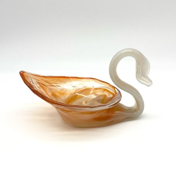 Small orange and white art glass swan